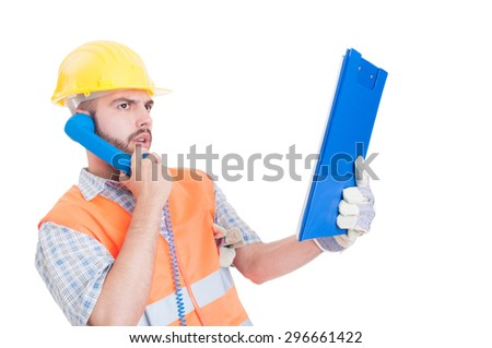 Confident contractor or builder using phone and holding clipboard isolated on white background - stock photo