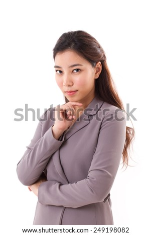 confident, cool, beautiful business woman looking at you - stock photo