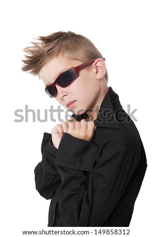 Confident cool boy with black dress shirt and sunglasses isolated on white background. - stock photo