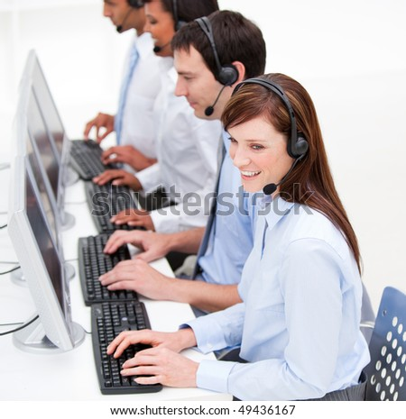 Confident customer service agents at work against  a white background