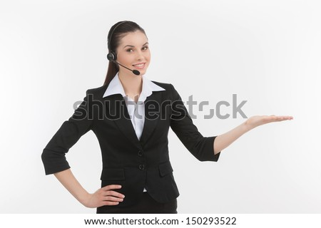 Confident customer service representative. Cheerful young female customer service representative in headset gesturing while isolated on white - stock photo