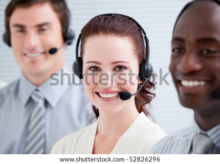 Confident customer service representatives with headset on standing in a line - stock photo