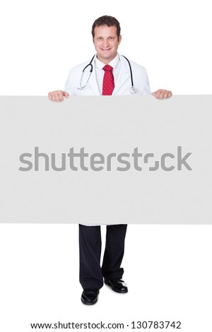 Confident doctor presenting empty banner. Isolated on white background - stock photo