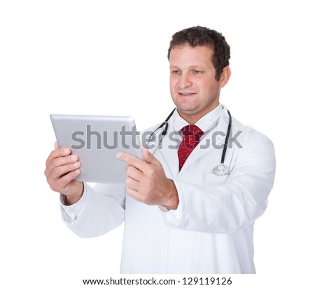 Confident doctor using digital tablet. Isolated on white background - stock photo