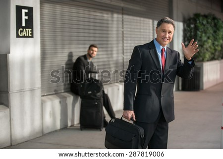 Confident elder successful man traveling at the train station - stock photo