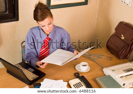 Confident elegance business woman manageress holding  documents - stock photo