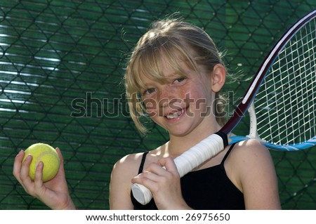Confident Elementary Age Girl with Tennis Ball and Racket. - stock photo
