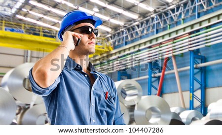 Confident engineer in a steel factory - stock photo