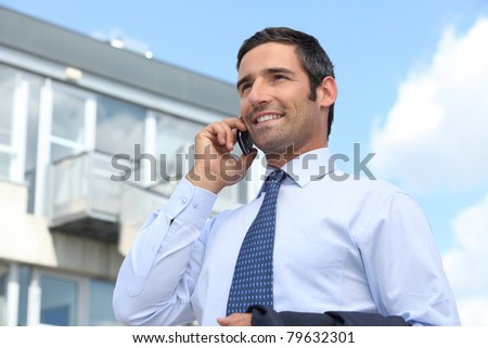 Confident estate agent outside building