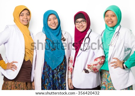Confident Female and muslim doctors isolated on white background - stock photo