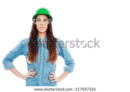 Confident female construction worker with red nails posing isolated white, empty space - stock photo