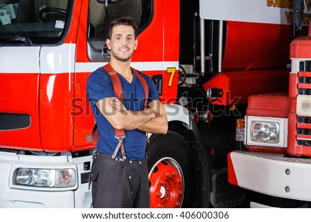 Confident Firefighter Standing Arms Crossed - stock photo
