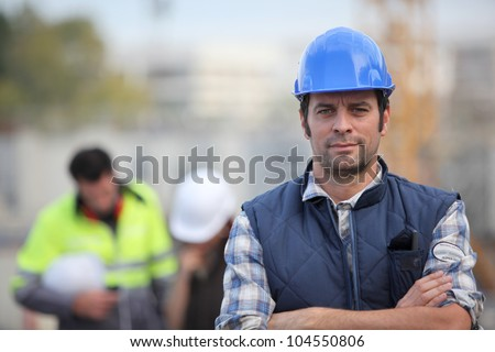 Confident foreman on construction site - stock photo