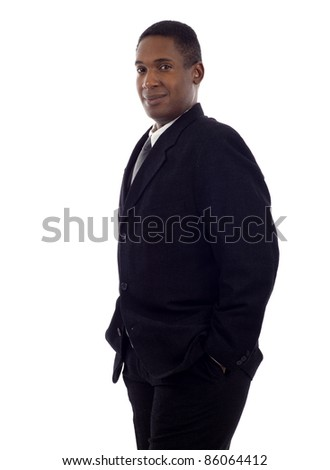 Confident good looking African American business man standing with hands in pockets isolated white background - stock photo