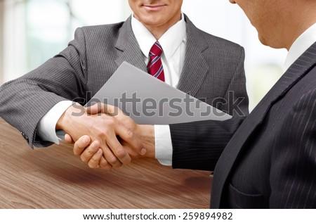 Confident Handshake - stock photo