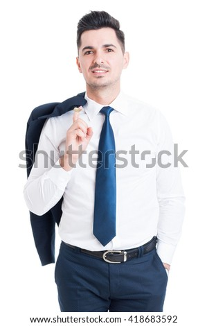 Confident handsome businessman holding his suit jacket  and smiling on white studio background - stock photo
