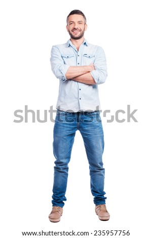 Confident handsome. Full length of handsome young man in casual wear keeping arms crossed and smiling while standing isolated on white background - stock photo
