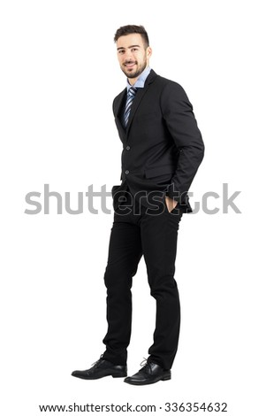 Confident happy business man with hands in pocket side view.  Full body length portrait isolated over white studio background.  - stock photo