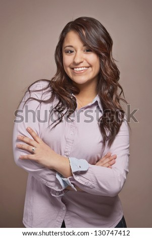 Confident happy mixed race young woman - stock photo
