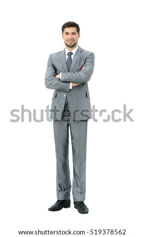 confident is a successful businessman in grey suit standing with