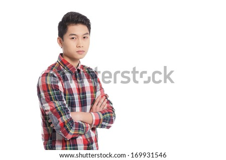 Confident look. Smiling Chinese teenage boy keeping arms crossed and smiling while standing isolated on white - stock photo