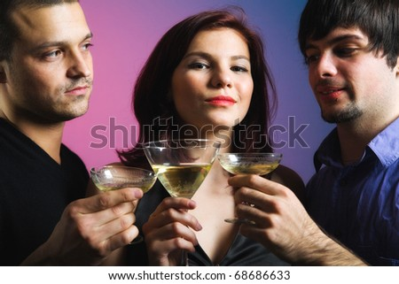 Confident looking woman and two men - stock photo