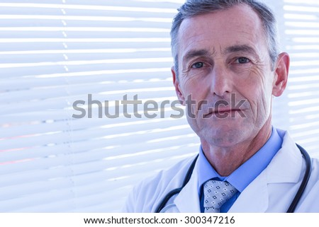 Confident male doctor looking at camera - stock photo