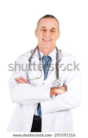 Confident male doctor with folded arms. - stock photo