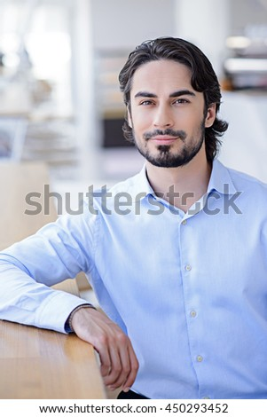 Confident male worker having rest - stock photo