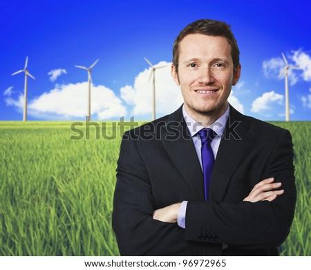 confident man and wind turbine background - stock photo