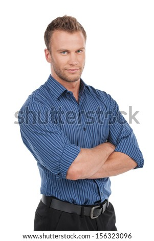Confident man. Confident young man keeping arms crossed and smiling while standing isolated on white - stock photo