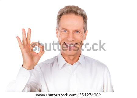 """Confident man gestures """"OK""""  suggesting acceptance, approval - stock photo"""