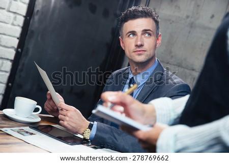 Confident man making order at restaurant - stock photo