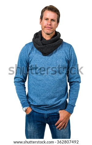 Confident man with hand in pocket standing against white background - stock photo