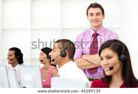 Confident manager checking his employee's work in the office - stock photo
