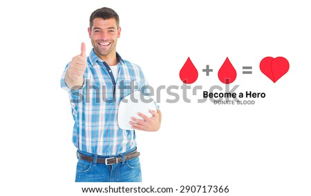 Confident manual worker gesturing thumbs up against blood donation - stock photo