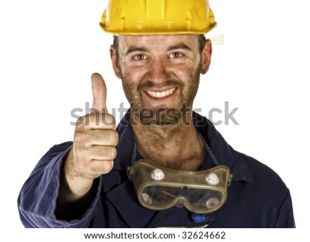 confident manual worker thumb up selective focus - stock photo