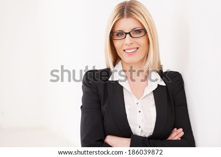 Confident mature businesswoman. Confident mature businesswoman keeping arms crossed and smiling - stock photo