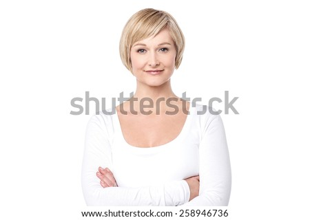 Confident middle aged woman posing to camera - stock photo