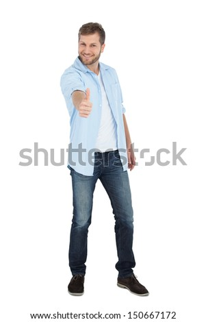 Confident model smiling and giving thumbs up against white background