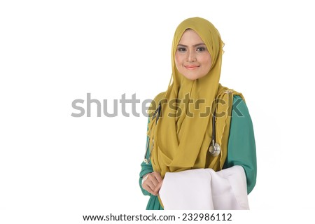 Confident Muslim female doctor standing with isolated white - stock photo