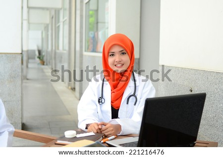 Confident Muslim medical student pose at hospital - stock photo