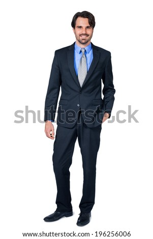 Confident relaxed business executive in a stylish suit standing smiling at the camera with his hand in his pocket, full length isolated on white - stock photo