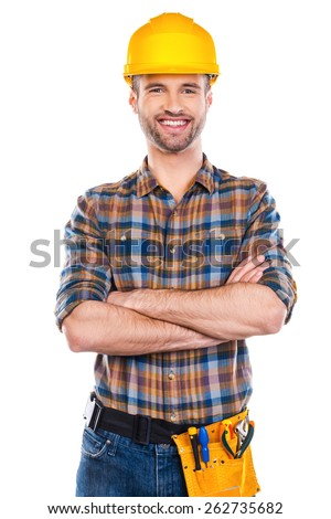 Confident repairman. Confident young male carpenter in hardhat keeping arms crossed and smiling while standing against white background  - stock photo