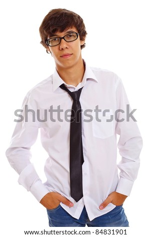 Confident serious teenage guy with hands in his blue jeans pockets wearing white shirt and weaken tie. Isolated on white background, mask included - stock photo