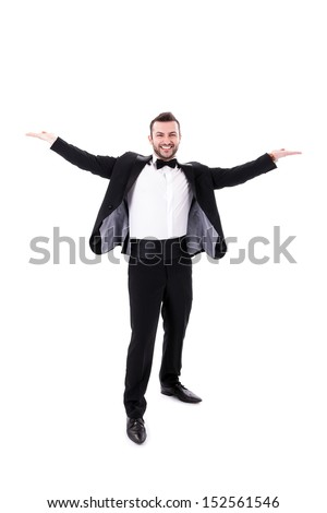 Confident Smart  Looking Man Smiling, spreading his arms, wearing tuxedo, isolated on white background, space for text - stock photo