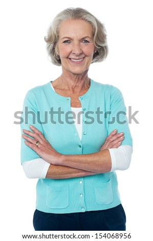 Confident smiling beautiful aged woman in trendy wear - stock photo