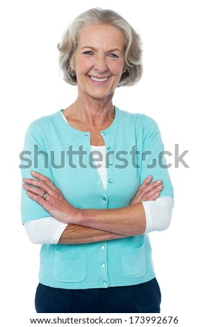 Confident smiling beautiful aged woman in trendy wear