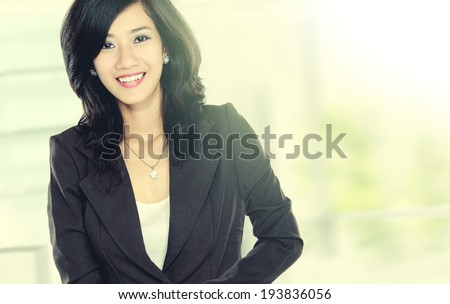confident smiling beautiful young business woman in the office walking in rush - stock photo