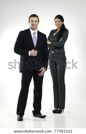 confident smiling male and female businesspeople - stock photo